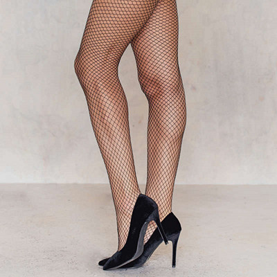 NA-KD fishnet tights