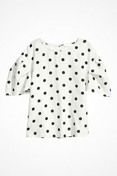 H&M svartvit prickig blus med ballongärm