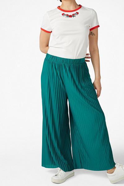 Monki gröna plisserade byxor med vida ben
