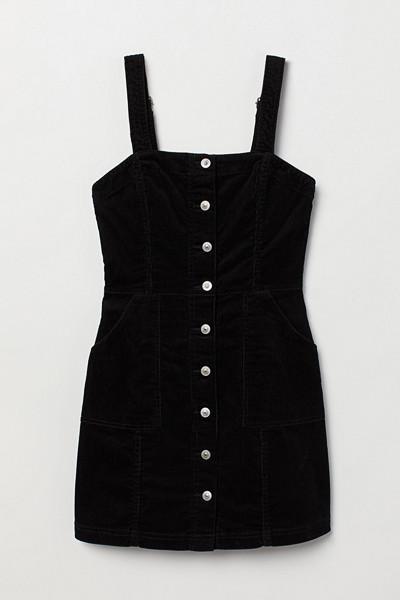 H&M svart hängselkjol i manchester