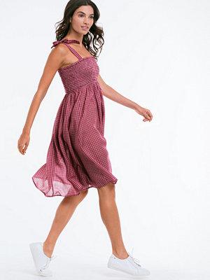 Ellos Vävd klänning med knyt på axlarna