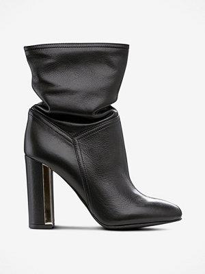 Apair Boots med guldfärgad detalj på klacken