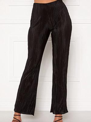 Chiara Forthi svarta byxor Kith plissé pants