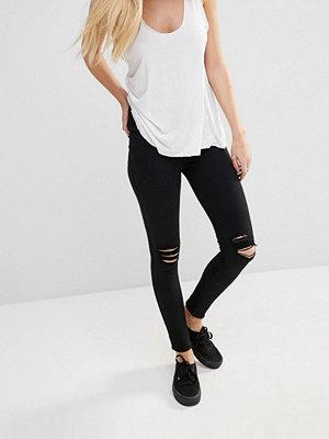 Dr. Denim Lexy Super skinny jeans med medelhög midja och revor på knäna som sitter som en andra hud