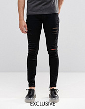 Jeans - Cheap Monday Low Spray Slash Extreme Super Skinny Jeans in Black Extreme Rips
