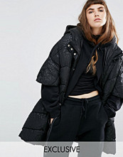 Kappor - Puffa Oversized Cape Jacket With Padded Collar And Hood In Tonal Leopard