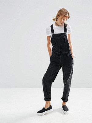 Jumpsuits & playsuits - ASOS DESIGN Svarta hängselbyxor i denim Tvättad svart