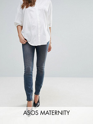ASOS Maternity LISBON Skinny Mid Rise Jean in Dita Tinted Mid Wash with Reverse Stepped Hem - Mid wash blue