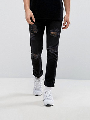 Jeans - Black Kaviar Skinny Jeans With Ripped Knees