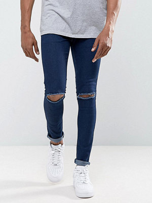 Jeans - Criminal Damage Super Skinny Jeans With Knee Rips