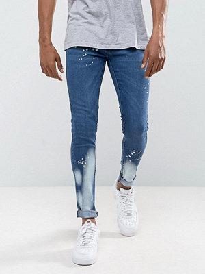 Jeans - Criminal Damage Super Skinny Jeans With Bleach