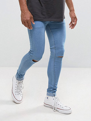 Jeans - Criminal Damage Super Skinny Jeans With Knee Rips And Raw Hem