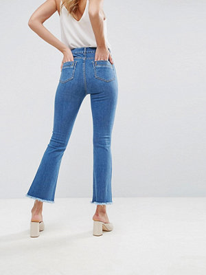 ASOS Crop Flare Jeans in Mid Wash Blue with Raw Hem