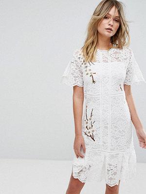 Liquorish Lace Dress With Blossom Embroidery