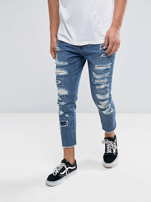 Cayler & Sons Skinny Jeans In Blue With Distressing And Raw Hem