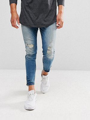 Jeans - Pull&Bear Carrot Fit Ripped Jeans With Zipped Hem In Mid Wash