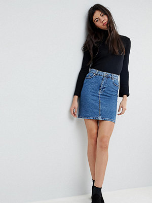 Asos Tall ASOS DESIGN Tall denim original high waisted skirt in midwash blue - Mid wash blue