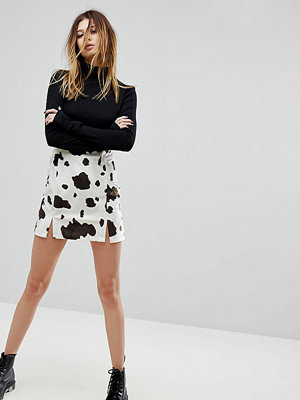 Milk It Vintage Split Front Mini Skirt In Cow Print