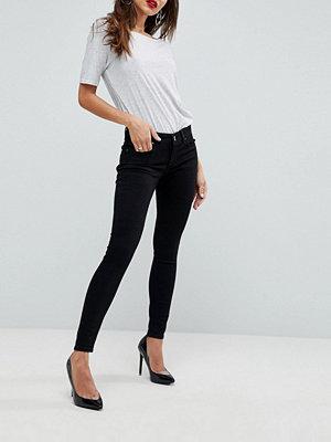 ASOS DESIGN Whitby Svarta smala jeans med låg skärning Rensvarta
