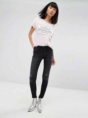 Cheap Monday Mid Spray Rip Knee Skinny Jeans