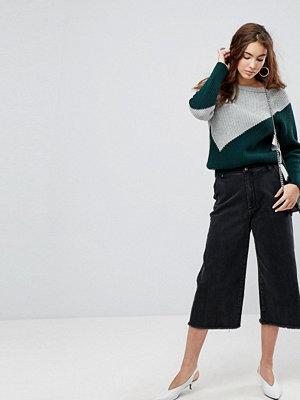 Evidnt Jeans med vida ben och råskurna benslut Blacktop