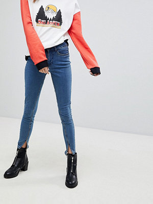 Noisy May Skinny jeans med slits nedtill Blå tvätt