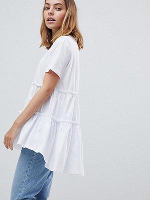 ASOS Petite T-shirt med lager av smock på fållen