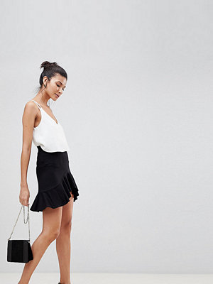 Asos Tall ASOS DESIGN Tall mini skirt with curved hem and frill