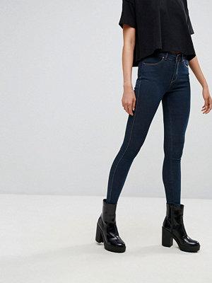 Dr. Denim Lexy Super skinny jeans med medelhög midja som sitter som en andra hud Mörkt stenfärgad