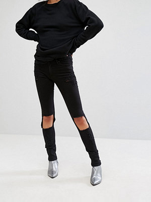 Cheap Monday Tight Destroyed Skinny Jeans