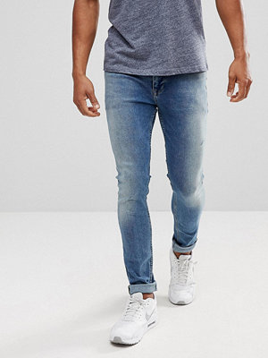 ASOS Extreme Super Skinny Jeans In Mid Wash Vintage With Abrasions