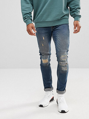 ASOS Extreme Super Skinny Jeans In Dark Wash Vintage With Rip And Repair