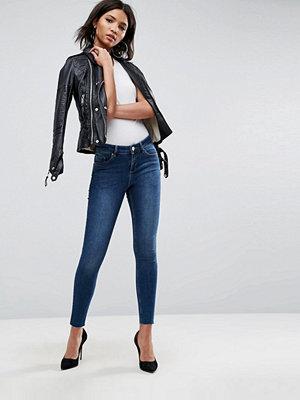 ASOS Lisbon Midrise Skinny Jeans in Kyla Wash with Raw Hem
