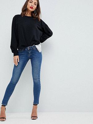 ASOS DESIGN Whitby supersmala stentvättade jeans med låg midja Mörk stentvätt