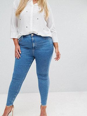ASOS Curve Ridley Skinny jeans med hög midja i lätt tvått Mellanblå tvätt