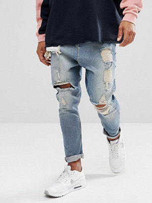 ASOS Drop Crotch Jeans In Vintage Light Wash Blue With Heavy Rips