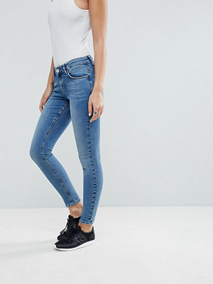 ASOS LISBON Mid Rise Skinny Jeans in Vienna Mid Wash Blue