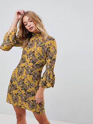 Parisian High Neck Floral Dress With Flare Sleeve - Mustard