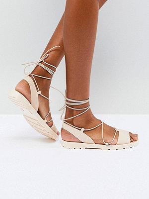 ASOS FLUTTER Tie Leg Jelly Sandals