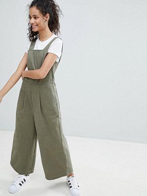 ASOS DESIGN denim jumpsuit with wide leg in khaki