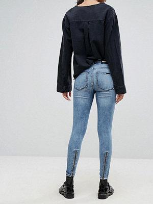 Dr. Denim Jeans med medelhög midja och dragkedjor baktill Worn light retro