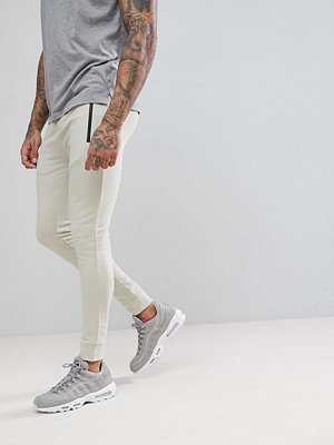 ASOS Super Skinny Joggers With Zip Pockets