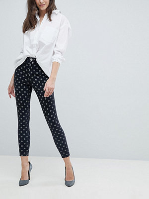 ASOS DESIGN Ridley high waist skinny jeans in polka dot print - Black polka dot