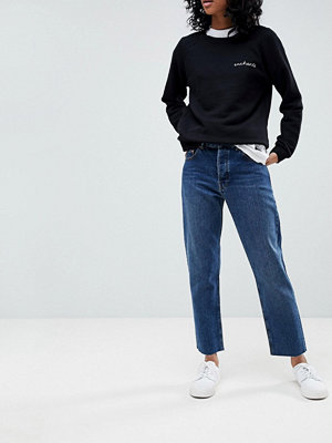ASOS DESIGN Florence authentic straight leg high waisted jeans in dark stone wash with raw hem detail - D