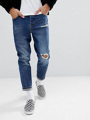 ASOS Twisted Seam Tapered Jeans In Dark Wash Vintage With Rips