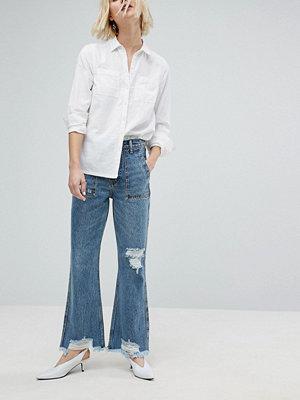 Evidnt Korta utsvängda jeans med råa kanter Fairfax