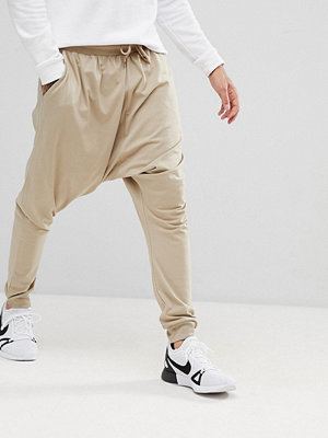 ASOS Lightweight Extreme Drop Crotch Jogger In Stone