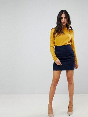 ASOS DESIGN denim seamed corset skirt in indigo