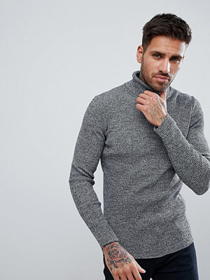 ASOS Knitted Muscle Fit Ribbed Roll Neck Jumper In Black And White Twist - Black and white
