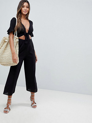 ASOS DESIGN tea jumpsuit with cut out and tie detail in linen